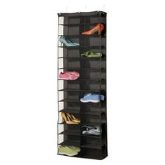 """Over-door shoe organizer in black. Holds twenty-six shoes.  Product: Shoe organizerConstruction Material: Polyester and vinylColor: BlackDimensions: 63"""" H x 22"""" W x 6"""" D"""