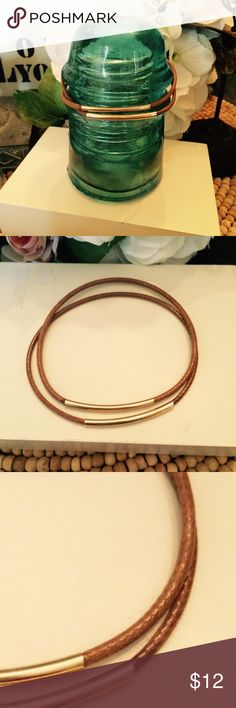 """. This is a set of 2 gold and brown leather bangles. Brown leather bangles with gold plated tubes. These just slide on your arm and you can wear them individually or stack. The leather cord is nice and thick and holds its round shape well.  Size: 1.26/16"""" thick and 8"""" around [ handcrafted handmade suede leather metal tag vintage bracelet charms artistic artist unique boho ] A.K.Lily Jewelry Bracelets"""