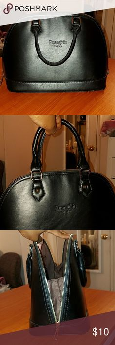 Used black bag Used black bag ..scuff marks on the bottom front...bag is 10.5 inches height ... 16 inches wide Bags