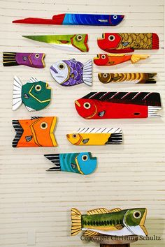 Reclaimed boat or barn wood painted as fish. So cool! I wonder if I could do this myself as a DYI project? Hmmmmm