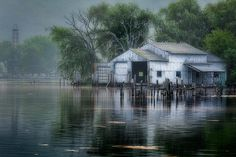 An old boathouse and marina on the shores of Seneca Lake in Watkins Glen New York looks a little spooky in the early morning mist and fog. Watkins Glen New York, Old Barns, Cape Cod, New England, Waterfall, Fine Art, House Styles, Summer, Photography