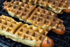 Cooked waffle dogs on waffle iron