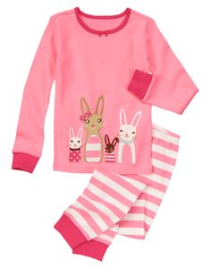 Playful two-piece pajama set features a group of cute bunnies all dressed up. Striped bottom with ribbed cuffs easily pulls on for comfort.