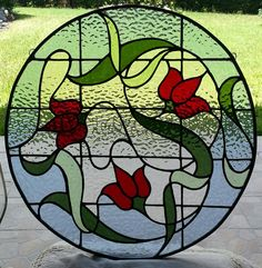 The outer border is really all light blue.just the grass in the background turning the top border green. Stained Glass Flowers, Stained Glass Designs, Stained Glass Panels, Stained Glass Projects, Stained Glass Patterns, Leaded Glass, Beveled Glass, Stained Glass Art, Mosaic Glass