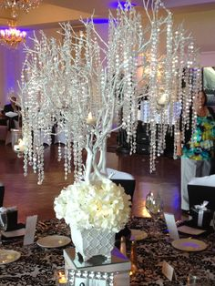 Wedding crystal tree. I'm thinkin' something similar with the real trees. Especially weeping willow trees
