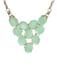 Ten brilliant heptagon stones form an intricately gorgeous necklace that's worthy of any special event!