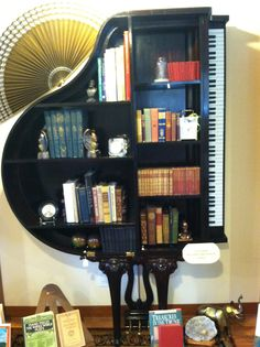 Piano bookshelf.. Adorable
