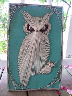 Nails and string owl