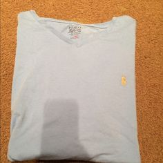 Polo by Ralph Lauren New light blue polo by Ralph Lauren shirt, soft material, no marks/rips barely worn perfect condition Polo by Ralph Lauren Tops Tees - Short Sleeve