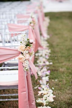 Acrylic chiavari chairs tied with pink sashes and decorated with blush and ivory bouquets to line the wedding ceremony aisle. Outdoor Wedding Venues, Wedding Ceremony Decorations, Aisle Decorations, Outdoor Ceremony, Wedding Trends, Wedding Styles, Wedding Ideas, Diy Wedding, Best Wedding Planner