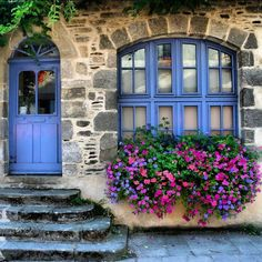 Rochefort en Terre, France - Loved the flowers under nearly every window in the town, invariably the flowers matched the paintwork!
