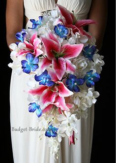 Impressive Blue Orchid and Stargazer Wedding Bouquet but add some white calla Lillie's