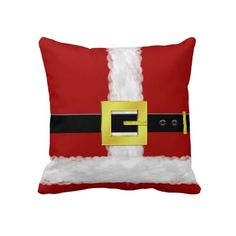 Santa Suit Christmas Pillow. Decorate this holiday season with a fun Christmas throw pillow that displays a bright red Santa Claus suit with a wide black belt and a gold buckle.