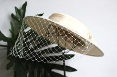 A personal favorite from my Etsy shop https://www.etsy.com/listing/487371261/cream-bridal-hat