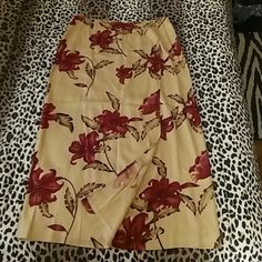 100% silk wrap Izod skirt 100% silk wrap skirt with beautiful  floral design  print pattern that would go really gorgeous with the sweater also listed separately which is a rich burgundy color. Tags not on but this item has never been worn. Colors are tan, brown leaves and rich burgundy flowers. Make me a reasonable offer please. IZOD Skirts