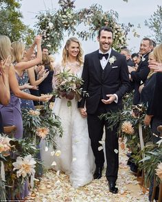 Official and awesome: Kate Upton sure is a smitten new bride. On Monday the supermodel sha...