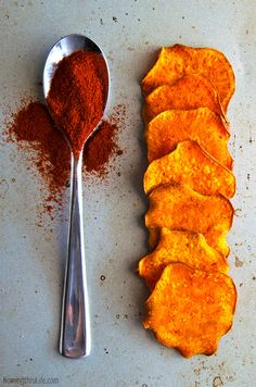 Spicy Baked Sweet Potato Chips - Crisp and crunchy sweet potato chips with a little kick that are BAKED and not fried! (Vegan & GF) Recipe @ NomingthruLife.com