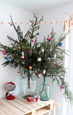 Thinking about having an alternative Christmas tree? Want to see the best ideas? We've rounded up the top 16 alternative Christmas tree ideas. Merry Little Christmas, Noel Christmas, Winter Christmas, Vintage Christmas, Christmas Crafts, Christmas Branches, Christmas Design, Green Christmas, Simple Christmas Trees