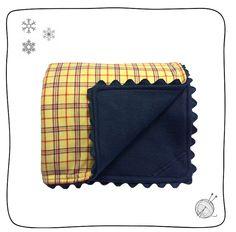 Manta flanela xadrez azul e amarelo com soft marinho. Medidas: 0,70 x 0,78 cm