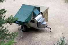 Teardrop camper with outdoor kitchen, add rooftop tent and side tent for changing. So simple and nature-friendly for backwoods camping!