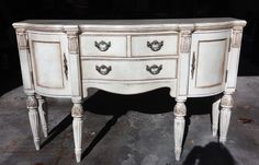 Sanding and dark wax softened the quite formal shape of this buffet.
