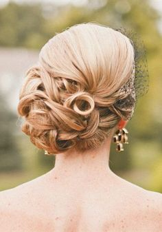 Side Bun Bridal Hairstyle - More Inspiration on The Knot