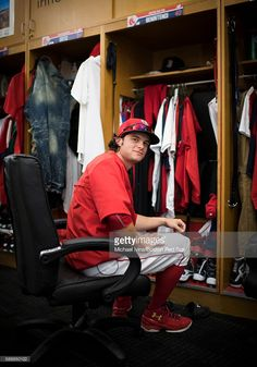 Andrew Benintendi #40 of the Boston Red Sox sits at his locker before a game against the Arizona Diamondbacks on August 12, 2016 at Fenway Park in Boston, Massachusetts.