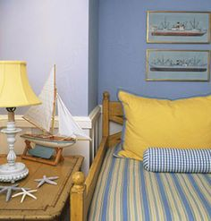 Nautical yellow and blue bedroom. I think I'd like it with a few touches of red thrown in.