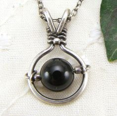 Sterling Silver Black Onyx Pendant Handmade Wire Wrapped Jewelry Worry Bead. $48.00, via Etsy.