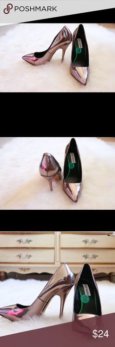 STEVE MADDEN Rose Chrome Pumps Product Description Bio:HOT! Yet so cool…these here pumps show mean business! Featuring a stiletto heel and smoked rose chrome finish. Details: vegan friendly,stiletto heel, pointed toe Heel: 5 inches Size: 8 US Color:Smoked Rose Chrome Condition:Excellent/Like New Steve Madden Shoes Heels