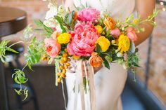 Flowers by Lace and Lilies, Summer Bright and Bold Bridal Flowers, Peony, Garden Rose, Ranunculus and Fruit Bouquet.