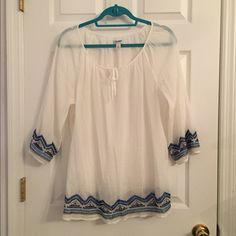 White flowy shirt w/ blue designs Lightweight white flowy 3/4 sleeve shirt with blue designs on the bottom of the shirt and sleeves. Only worn a few times, in perfect condition!! Perfect for a cool summer night! Offers are welcome :) Old Navy Tops