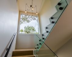 Re-clad, Interior Renovation and Third Level Extension in Mairangi Bay. Call us for the best renovations & service! Staircases, Auckland, Hallways, Third, Sunrise, Construction, Dreams, Number, Building