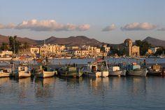 into the sunset light - Aegina port by laxpix