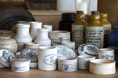 collection of antique clay advertising jars and bottles (from France and England.   I love these.