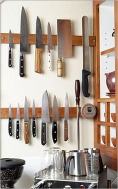 wooden magnet knife strip - organized and not damaging to the blades. if i had any knives worth protecting, i'd be all over this :)