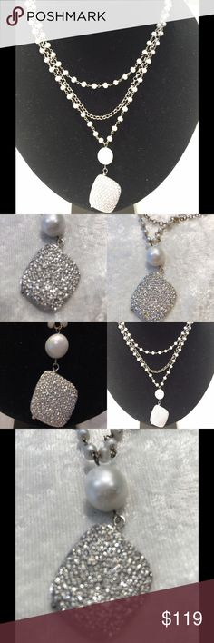 Swarovski Crystals + fresh water pearls necklace This beautiful fresh water pearls and Swarovski embellishment as a center pendant necklace with a silver Rollo chain was hand made by local designer. Original price $345.00 Jewelry Necklaces