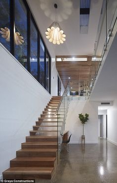 Modern: The Grays have transformed the property into an expansive family home and have already sold it Stainless Steel Staircase, Glass Stairs, Steel Stairs, Modern Stairs, Tower House, Million Dollar Homes, Storey Homes, Water Tower, Modern Glass