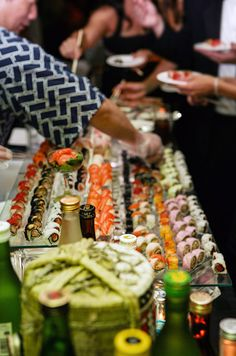Mouthwatering sushi is easily accessible to guests when displayed on floating glass trays of varying heights.