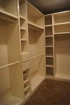 The custom closet design provides more storage to include hanging items, shoes, and drawer space. The custom designed tile floor is laid on a diagonal pattern transitioning from the master bathroom. The floor opens up the closet space giving the appearance of a much larger closet.