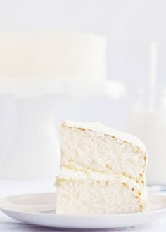 "Fluffy Vanilla Cake with Whipped Vanilla Bean Frosting - This is THE BEST vanilla ""white"" cake.  Fluffy, mildly sweet, moist without crumbling."