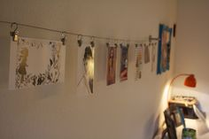 hanging art with wire - Google Search