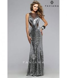 Please allow a 4 day handling time before this dress ships.  A sparkling silver designer dress! This glamorous mermaid silhouette is sexy with black mesh details and cut outs. A large alluring keyhole back completes this ravishing gown. A perfect choice f