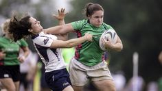 Women's player from Northeast Philadelphia Irish Rugby Club stiff arming her way past a defender at the 2017 North Penn 7s Tournament.