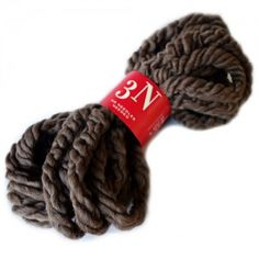 Feza 3N Yarn | Feza 3N is a super bulky wool blend yarn with a hint of lycra. It's a lightly twisted wool roving available in all natural shades. You can even make a quick scarf without needles (see video).  Comes in 12 colors.