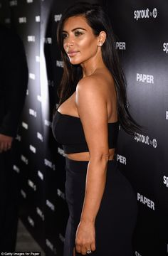 Kim Kardashian flashes leg in slinky maxi skirt and crop top at release of THAT Paper magazine issue | Daily Mail Online