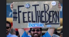 Frank Rothstein holds a sign before a rally for Democratic presidential candidate Sen. Bernie Sanders, I-Vt., Monday, Aug. 10, 2015, at the Los Angeles Memorial Sports Arena in Los Angeles. (AP Photo/Ringo H.W. Chiu)