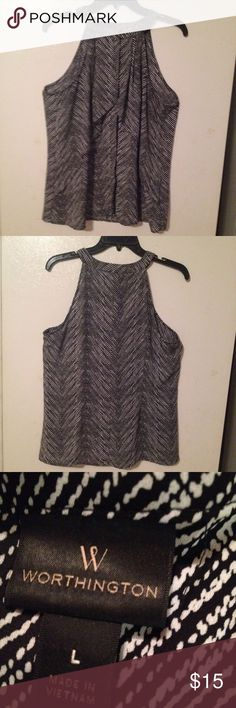 Worthington sleeveless blouse size L Worthington black and white sleeveless blouse size L. Front has layer and button front closure. Worthington Tops Blouses