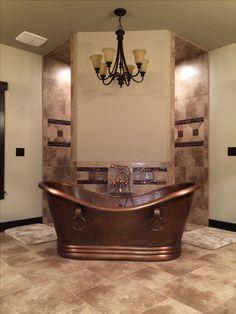 Rustic bathroom, hammered copper tub in front of a corner walk through shower. Dream spa bathroom