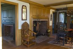 Cape Cod/Colonial Fireplace: Raised Wood Paneling, sconce, color scheme, wainscoting, chandelier